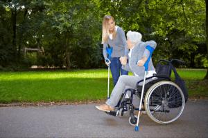 caregiver assisting patient to walk